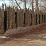 Unacceptable: Coyote fence with railroad ties